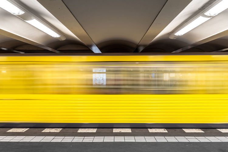Architecture Motion City Train Station Subway Station Travel Speed Symmetry Outdoors Illuminated Yellow Public Transport U-Bahn Transportation Long Exposure Public Transportation No People U-Bahnhof Subway Train My Best Photo Blurred Motion Rail Transportation Train - Vehicle Mode Of Transportation The Traveler - 2019 EyeEm Awards The Architect - 2019 EyeEm Awards