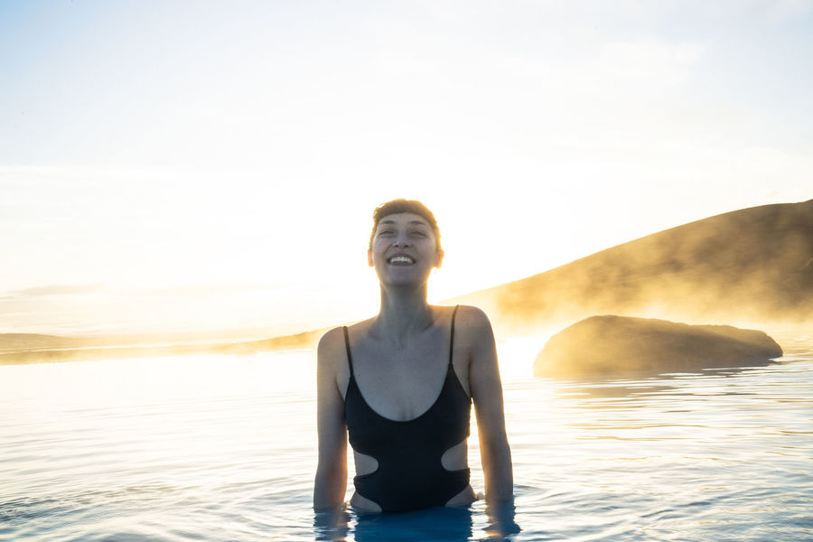 Days of travel: 8 - Mývatn Nature Baths Iceland Sunlight Adult Beach Front View Golden Hour Happiness Leisure Activity Lifestyles Mouth Open Nature One Person Outdoors Real People Sea Sky Smile Smiling Sunlight Sunset Traveler Water Women Young Adult Young Women The Traveler - 2018 EyeEm Awards