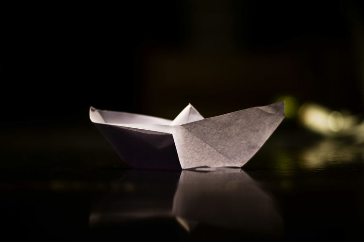 Close-up of paper boat on table