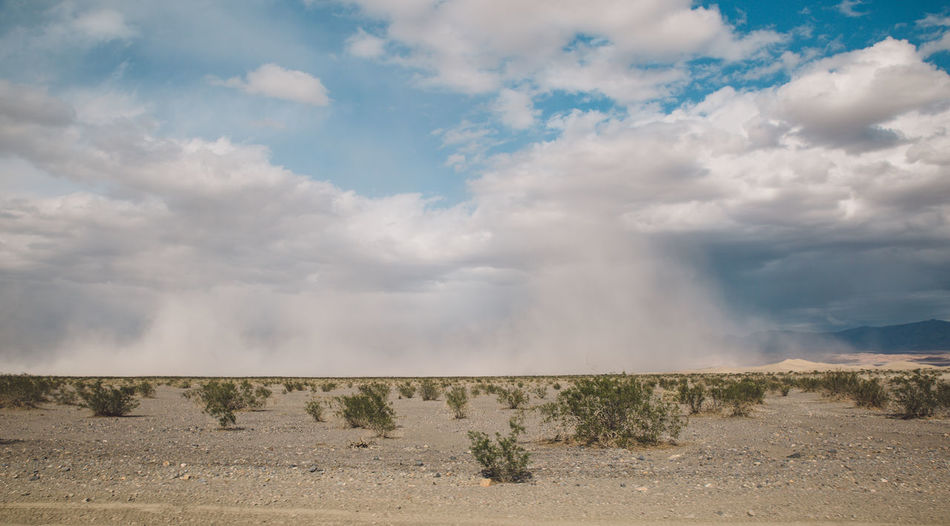Scenic View Of Landscape Against Cloudy Sky At Death Valley National Park