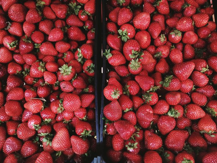 Full frame shot of strawberries in box at market for sale