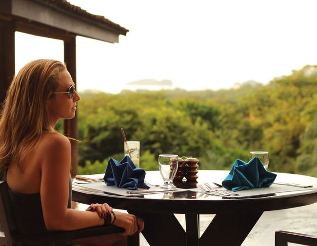 Done That. Table Drink Sitting Food And Drink Eyeglasses  Coffee - Drink Drinking Young Adult Day Drinking Glass Young Women Outdoors Adults Only Adult One Person Only Women People Costa Rica Boutique Hotel Coco Beach Honeymoon Travel Destinations Travel Beach