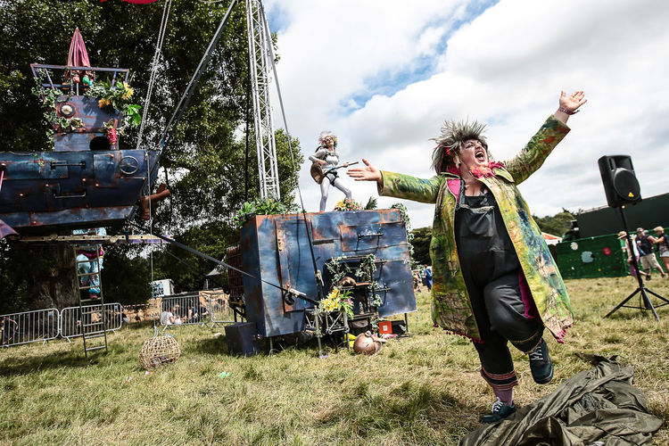 Scenes from the 2016 Latitude festival in Southwold, Suffolk. Casual Clothing Cloud Cloud - Sky Cloudy Day Festival Field Grass Grassy Landscape Latitude Latitude Festival Leisure Leisure Activity Lifestyles Nature Outdoors Plant Relax Relaxation Rural Scene Sky Theatre