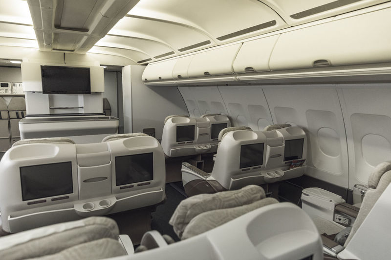 Seat Empty Vehicle Interior Vehicle Seat Absence Indoors  In A Row No People Airplane Seat Airplane Air Vehicle Transportation Mode Of Transportation Travel Public Transportation Passenger Cabin Large Group Of Objects Window Side By Side Commercial Airplane Luxury Clean