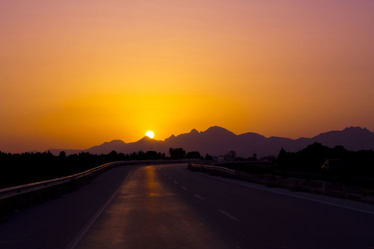 Beauty In Nature Landscape Live For The Story Mountain Nature No People Orange Color Outdoors Peaceful Road Road Roadtrip Scenics Silhouette Sky Summersunset Summertime Sun Sunset Sunset Silhouettes Sunset_collection The Way Forward Tranquil Scene Tranquility Transportation