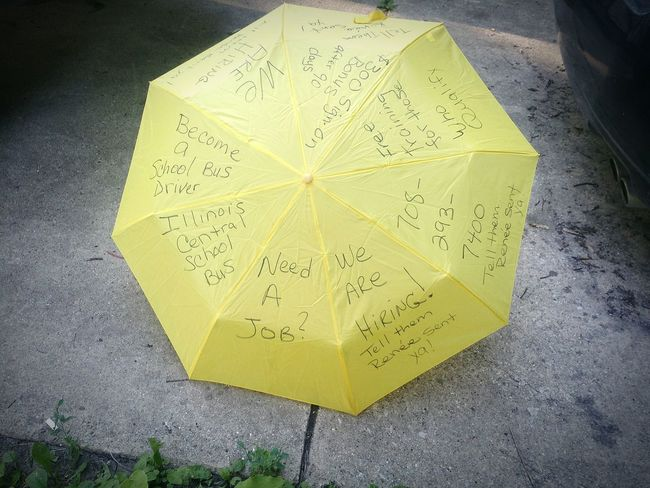 Recruiting tool Umbrellas Yellow High Angle View Text Close-up Information Sign
