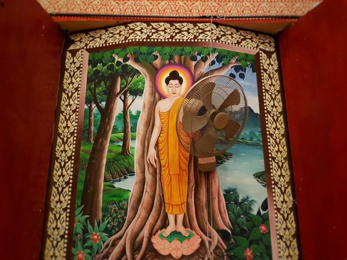 Painting Buddha with electric fan at Electric Fan Fan Cultures Culture Buddhism Buddhist Temple Asians Asian  ASIA Thai Thailand Sculpture Buddha Craft Art Sculpted Statue Art And Craft