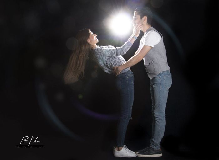 Lens Flare Illuminated Young Adult Spotlight Young Women Adult (null)People Black Background Portrait Studio Shot Togetherness Adults Only PouriaNaseri© PoucoFotografia©