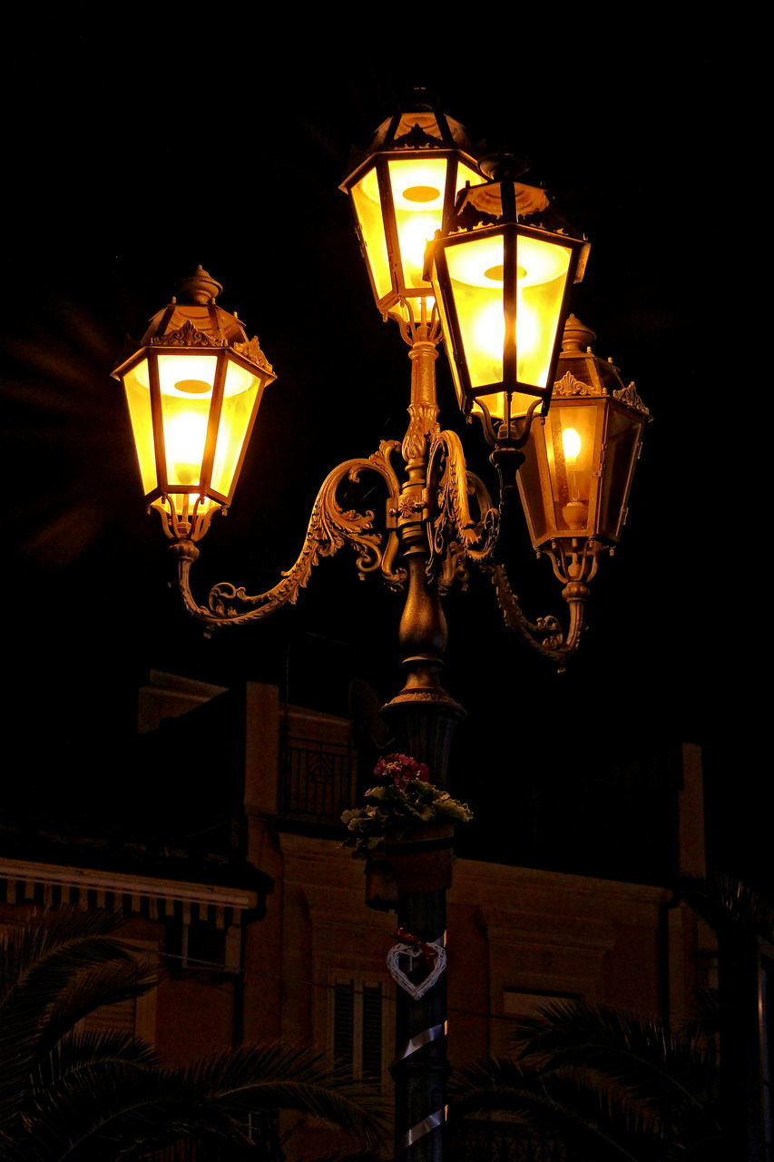 illuminated, lighting equipment, night, street light, electric light, wall lamp, street lamp, gas light, lantern, no people, low angle view, light bulb, electricity, outdoors, architecture, close-up, sky
