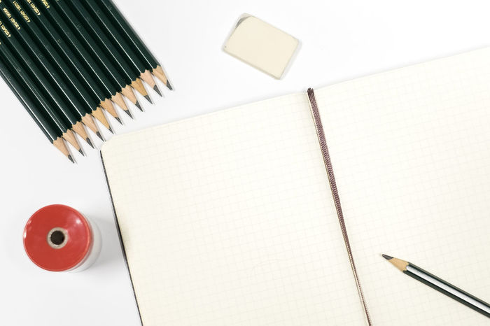 Begin to sketch Blank Diary Drawing No People Note Pad Notebook Notice Office Office Supply Paper Pencil Pencil Drawing Sharpener Sharpeners And Pencils Sketch Sketchbook Spiral Notebook Studio Shot White Background Writing Instrument