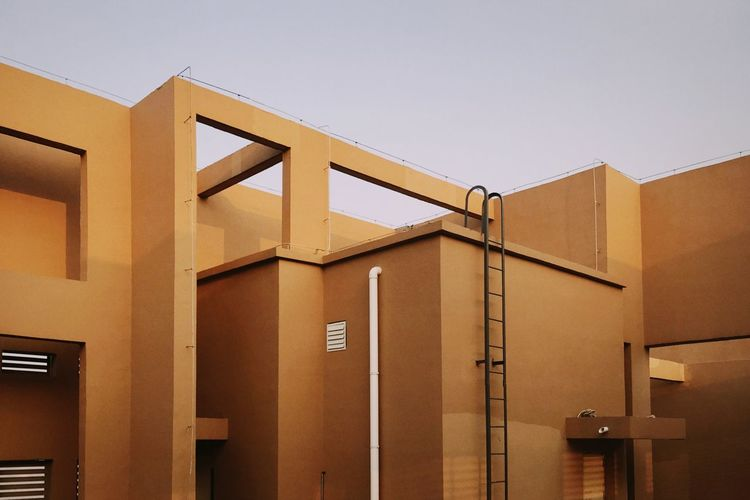 IPhone7Plus NOMO 男仔很忙 Architecture Built Structure Building Building Exterior Sky No People Clear Sky Nature Entrance Outdoors Low Angle View Container Wall - Building Feature Number Copy Space Modern Large Group Of Objects Door Day Box