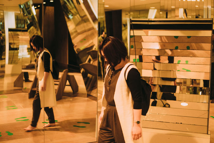Side view of people standing in shopping mall