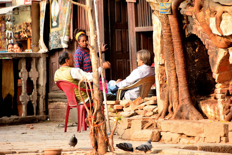 Kathmandu Nepal Adult Architecture Basantapur Casual Clothing Child Childhood Daughter Day Family Females Full Length Girls Males  Men Mother Offspring People Sitting Son Togetherness Women
