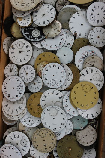 Abandoned clocks in crate