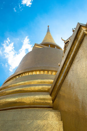 Architectural Feature Architecture Blue Built Structure Cloud Cloud - Sky Cultures Day Design Famous Place Golden Grand Palace Bangkok Thailand Low Angle View No People Ornate Outdoors Pagoda Place Of Worship Religion Spirituality Stupa Temple Temple - Building Tourism Travel Destinations