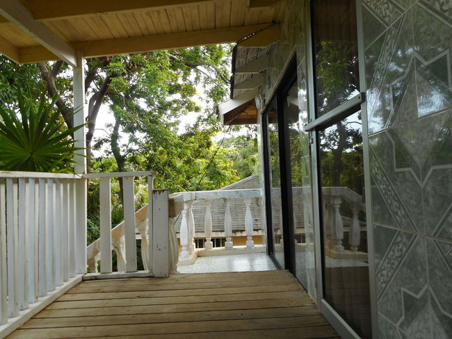 Honduras Roatan Architecture Balcony Bay Islands Beauty In Nature Building Exterior Built Structure Day Nature No People Outdoors Porch Railing Sky Tree Wood - Material