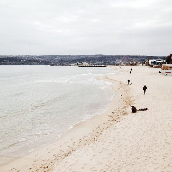 People Sea And Sky Beach Sand Real People Scenics Shore Winter Sea Fishing Fisherman Sea Seashore Seascape Varna,Bulgaria By The Sea Seaside Tranquility Beauty In Nature Leisure Activity Vacations Wave Winter Beach Cold Sea Tranquil Scene Beauty In Nature