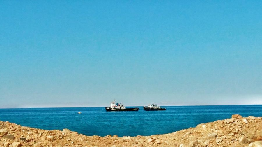 The Traveler - 2018 EyeEm Awards Egypt Nature Blue Sky Sand Egyptphotography Everydaymoments Water Clear Sky Sea Beach Blue Offshore Platform Drilling Rig Sunny Sky Horizon Over Water Boat Waterfront Seascape Sailing Boat Water Vehicle Calm Coast Nautical Vessel Wake - Water