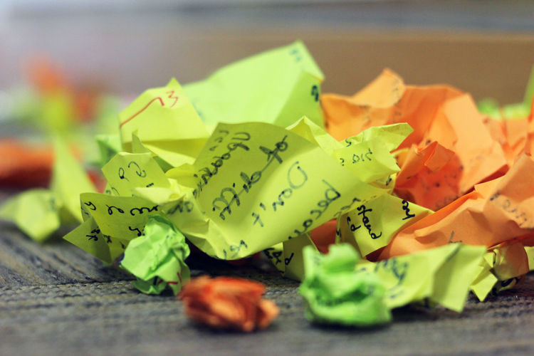 Close-up of crumpled sticky notes