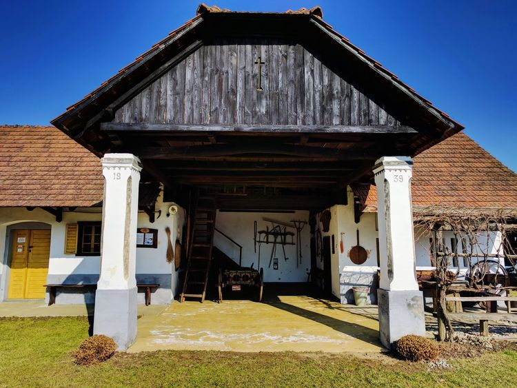 Architecture Built Structure Building Exterior No People Sky Outdoors Day Roof Tile White Old-fashioned Old House Old Farm Farm Farmhouse Old Farmhouse Springtime Spring Old Windows Wood Architecture House Pottery Roofline Roof Clear Sky