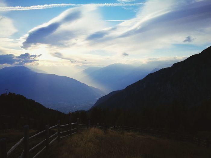 sunset over vinschgau Tree Mountain Sky Landscape Cloud - Sky Mountain Range Foggy Lush - Description Calm Atmospheric Mood Tranquility Cumulus