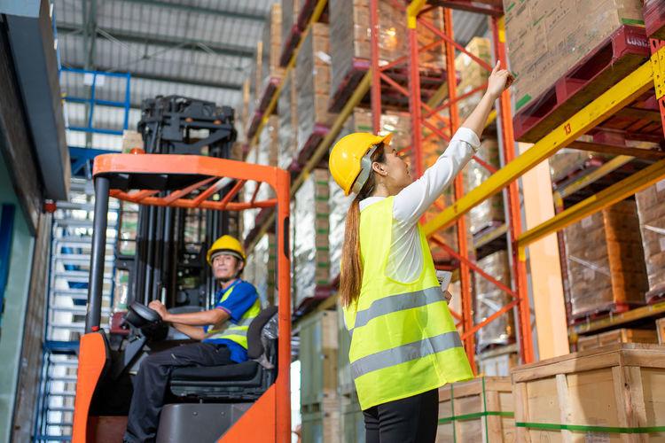 Full length of men working