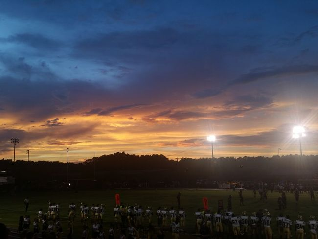 The Color Of School Sunset Dramatic Sky Cloud Tranquil Scene Scenics Atmosphere Sun Tranquility Sunbeam Sky Atmospheric Mood Dark Beauty In Nature Cloud - Sky Agriculture Majestic Nature Vibrant Color Outdoors Multi Colored High School Football High School Sports Sports American Football