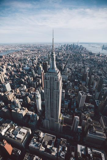 High angle view of empire state building amidst city against sky