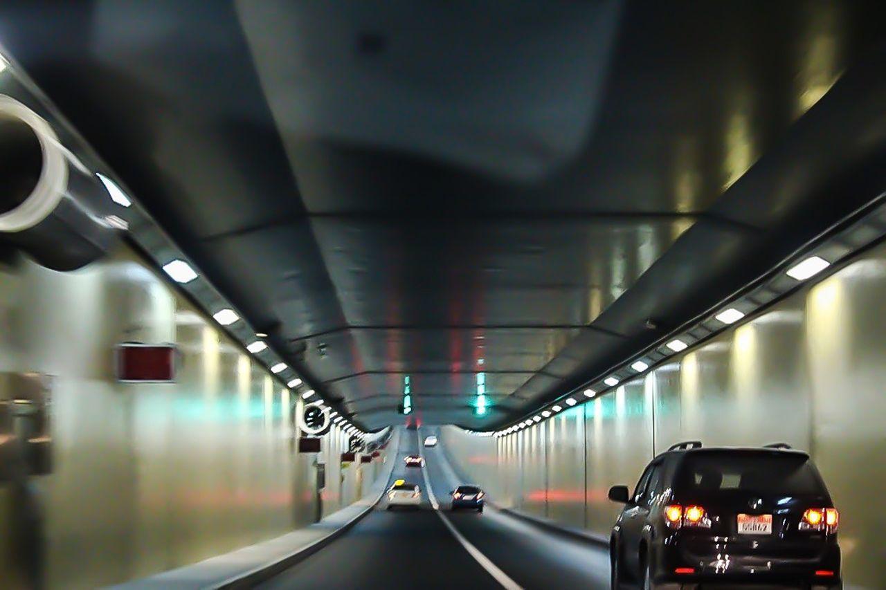 CAR IN ILLUMINATED TUNNEL