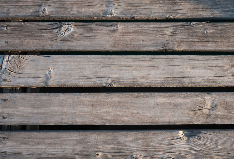Wooden dock surface top view Above Backgrounds Close-up Day Hardwood No People Outdoors Pattern Plank Surface Textured  Timber Top View Weathered Wood - Material Wood Grain