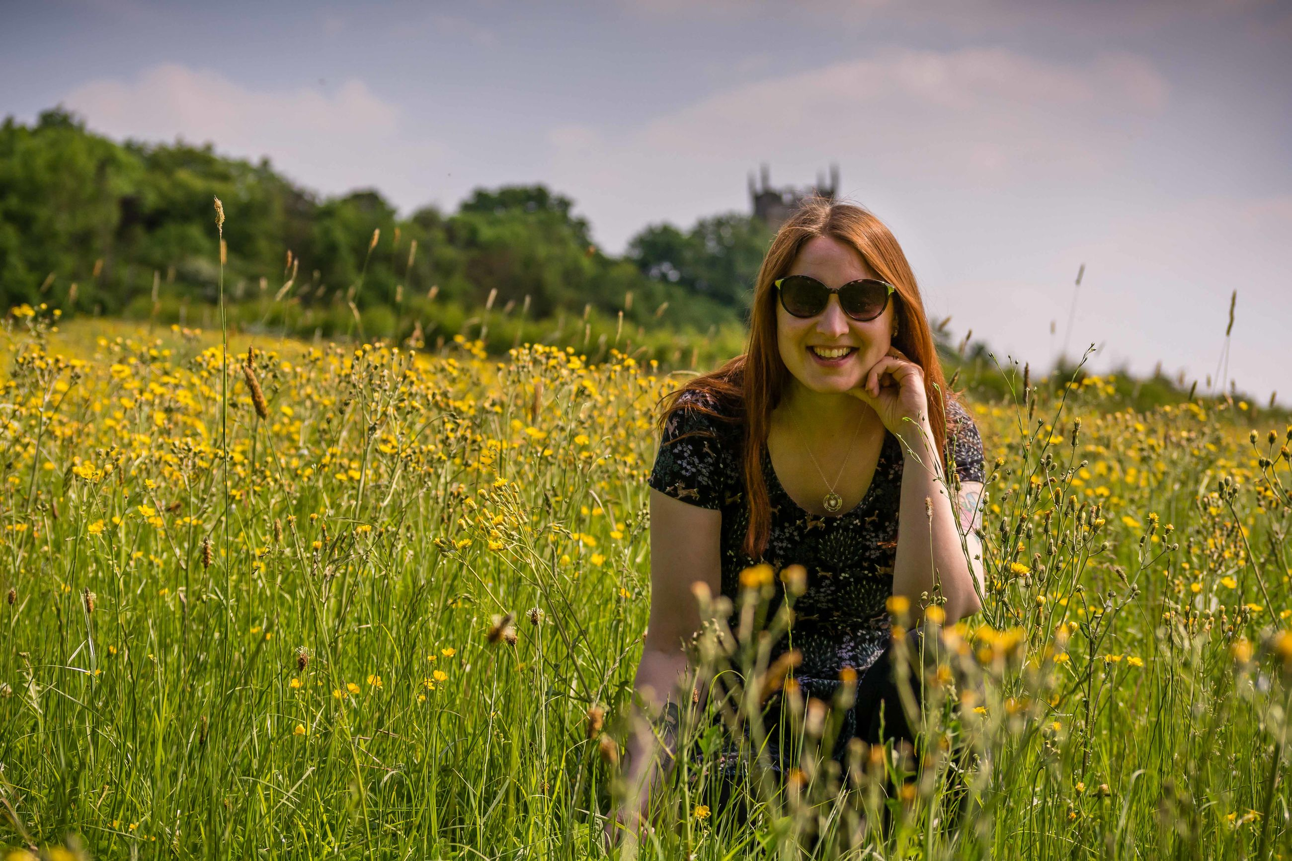 yellow, plant, field, one person, flower, grass, sunglasses, adult, meadow, fashion, nature, land, women, sky, rapeseed, landscape, glasses, rural scene, smiling, young adult, flowering plant, sunlight, agriculture, long hair, happiness, hairstyle, beauty in nature, rural area, front view, summer, portrait, environment, leisure activity, emotion, lifestyles, canola, outdoors, plain, three quarter length, crop, casual clothing, growth, prairie, day, clothing, green, natural environment, grassland, enjoyment, freshness, cheerful, tranquility, female, looking at camera, morning, mustard, springtime, autumn, carefree, wildflower, standing, holiday, brown hair, waist up, vacation, trip, blond hair, relaxation, cloud, food, teeth