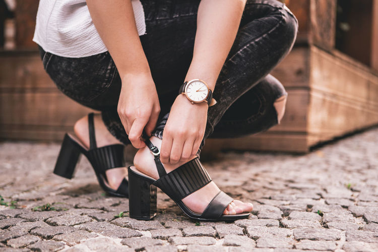 Close up portrait of Young woman city lifestyle with Watch on her wrist Low Section Shoe Fashion Women One Person Adult Human Leg Real People Lifestyles Human Body Part High Heels Standing Day Outdoors Focus On Foreground Body Part Footpath Leisure Activity Black Color Nail Human Limb Fashion Blogger Watch Urban Urbanphotography City Ljubljana Slovenia Portrait Portrait Of A Woman Woman Young Adult Young Women Casual Clothing Casual Look