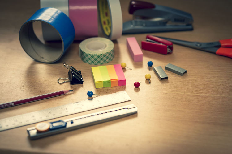High angle view of office supplies on table