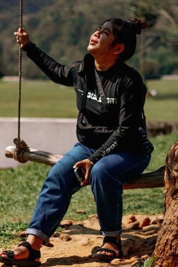 Full length of man sitting on field