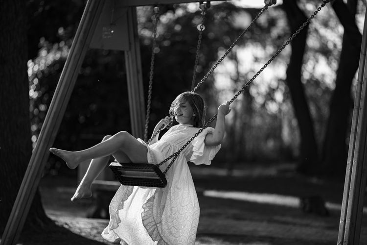 Girl Swinging At Playground
