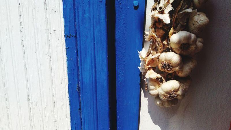 EyeEm Selects Greece Greek Islands Aglio Garlic Garlic Bulbs Greek Food Tzaziki Door Close-up Wood - Material Day No People Stuffed Toy Blue Backgrounds