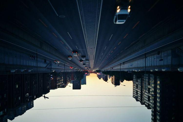 Reflection of bridge on mirror