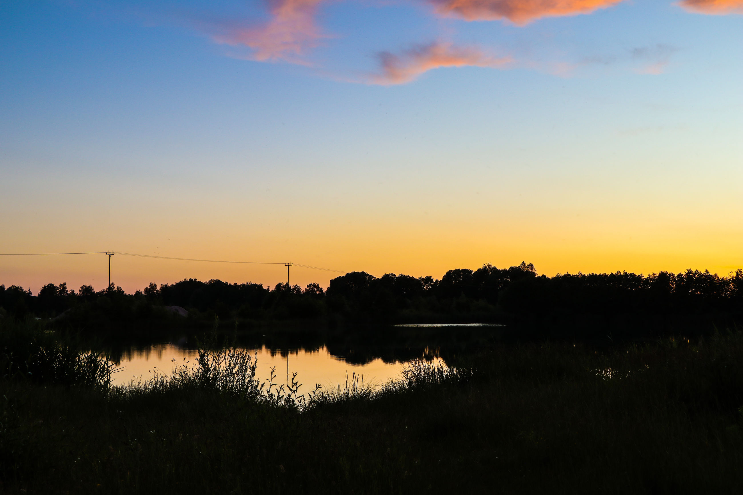 sky, sunset, beauty in nature, scenics - nature, tranquility, water, tranquil scene, nature, dawn, plant, environment, landscape, reflection, cloud, afterglow, silhouette, lake, no people, evening, orange color, horizon, tree, idyllic, sun, non-urban scene, outdoors, grass, land, sunlight, twilight, red sky at morning, field