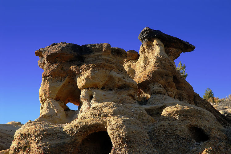 Rocky structure against clear sky