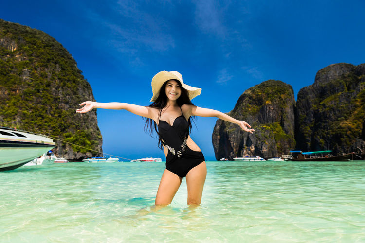 Beautiful Woman Beauty In Nature Day Front View Human Arm Leisure Activity Lifestyles Limb Nature One Person Real People Sea Sky Standing Swimwear Trip Water Women Young Adult Young Women