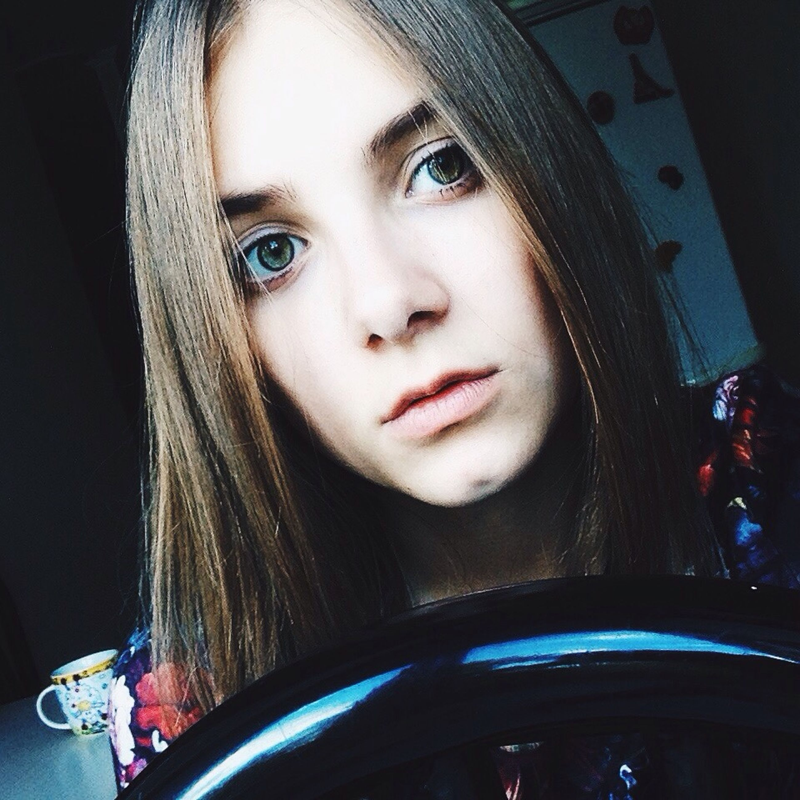 looking at camera, portrait, young adult, young women, person, headshot, lifestyles, front view, car, long hair, leisure activity, transportation, indoors, close-up, land vehicle, smiling, human face