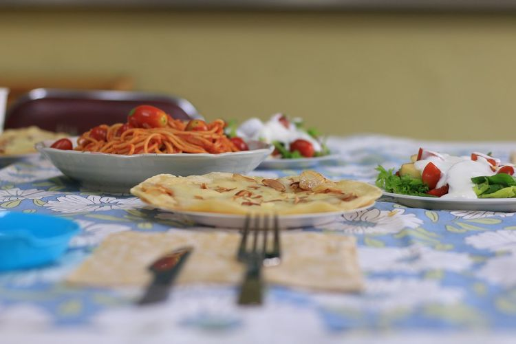 Close-up of food served in plates on table