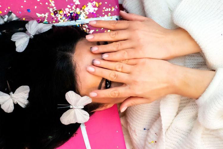 Close-up of woman hand holding pink flowers