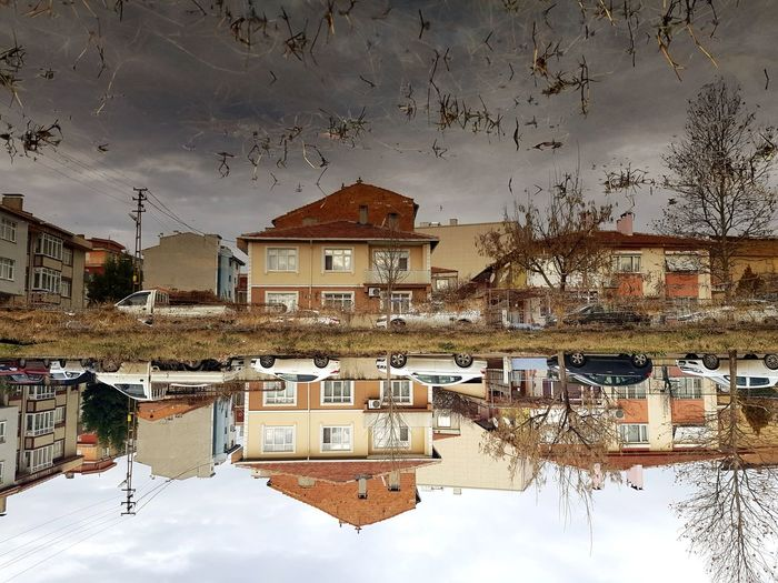 Houses in town against sky during winter