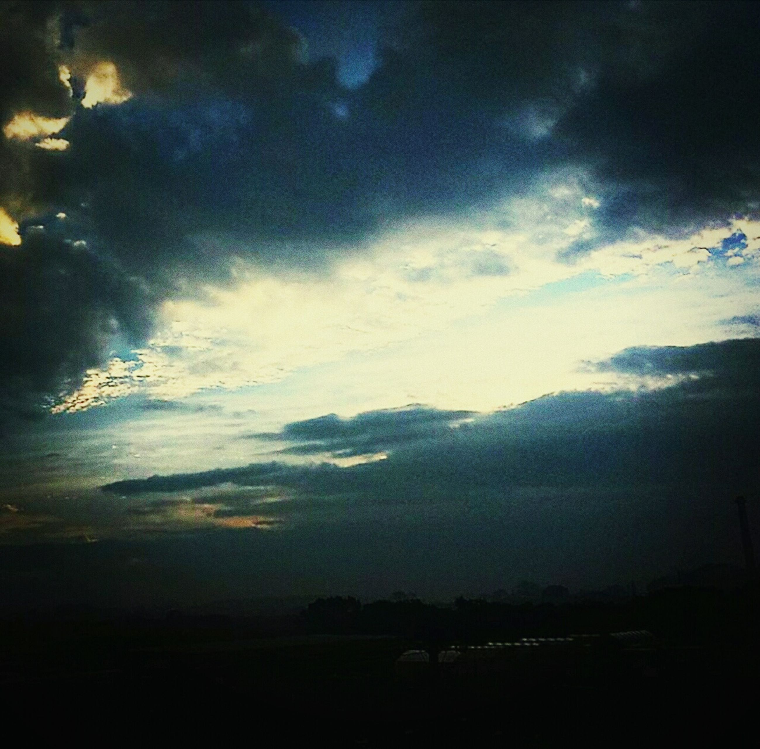 sky, cloud - sky, tranquility, tranquil scene, scenics, silhouette, beauty in nature, cloudy, nature, landscape, dusk, sunset, cloud, weather, idyllic, dark, outdoors, no people, overcast, dramatic sky