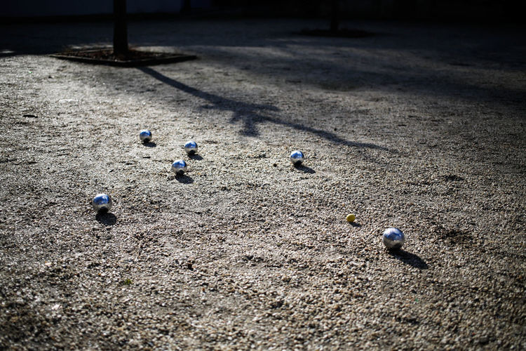 Shiny balls from petanque game in sunlight