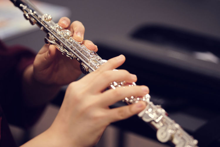 Cropped Image Of Hands Holding Flute