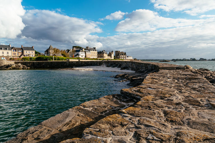 Waterfront of Roscoff Nature Day Outdoors Brittany France Roscoff Water Built Structure Cloud - Sky Architecture Sky Building Exterior Sea Building Scenics - Nature No People Waterfront Finistere Harbour Coast Coastline Europe Travel Rock Rock - Object Solid Land Beach Beauty In Nature Pier