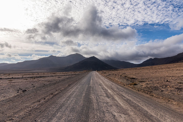 Panoramic view of land road against sky