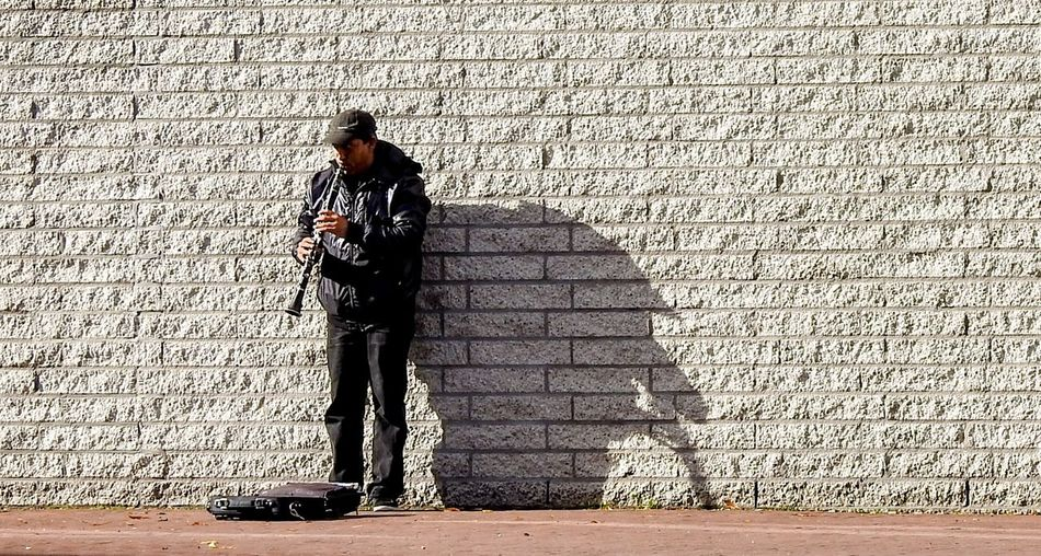 Nobody to listen, but it doesn't matter Streetphotography EyeEmNewHere Eyeemawards2018 Street Life Street Portrait EyeEm Selects Amsterdam Amsterdamcity Iamsterdam Nikonphotography EyeEm Best Shots Theplayer FreeArtist Artistic Trumphet Standing Communication Shadow Street Art